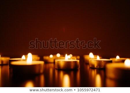 mãos · luz · de · velas · fogo · igreja · noite · preto - foto stock © stevanovicigor