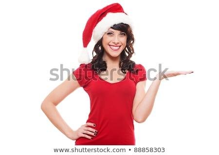 happy woman in santa hat holding something on palm Stock photo © dolgachov