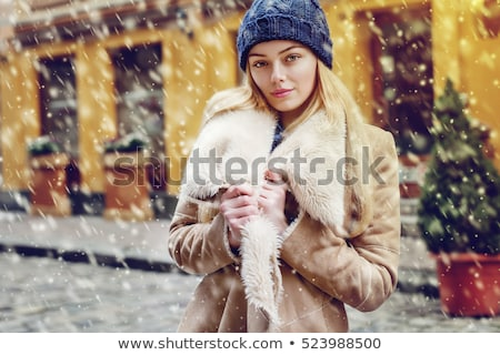 Young pretty smiling woman in fur coat Stock photo © Aikon