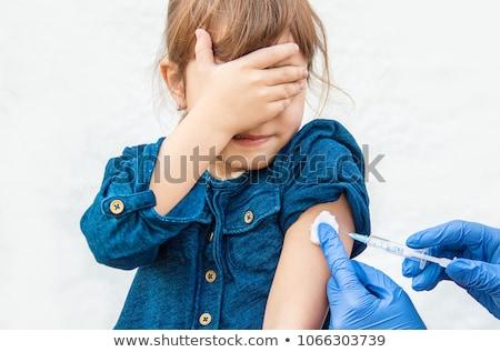 Injekciós tű gyermek gyógyszer egészségügy ijedt orvos Stock fotó © ia_64