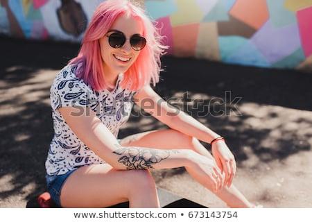 Séduisant souriant jeune femme tatouage mains portrait Photo stock © deandrobot