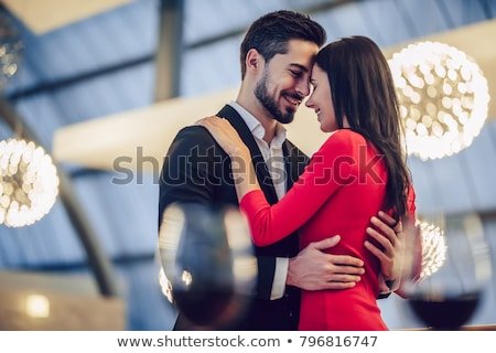 Elegant young couple dancing at night Stock photo © dash
