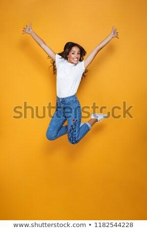 Alegre mujer saltar posando oscuro retrato Foto stock © deandrobot