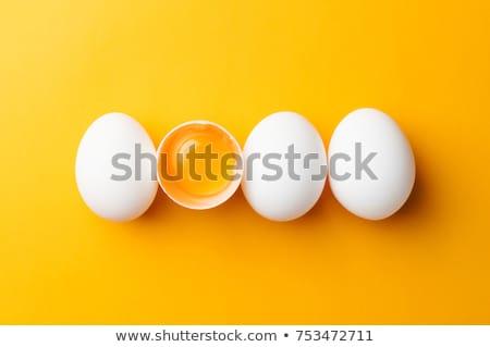Ruw ei eierdooier gebroken shell half Stockfoto © Digifoodstock