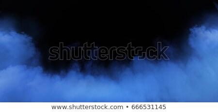 Blue smoke swirling in the grungy, dark interior Stock photo © konradbak