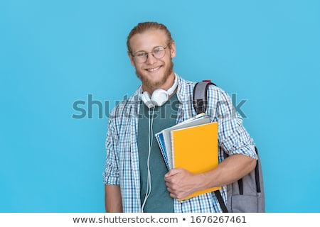 bearded student holding copybooks and looking at camera isolated on white Stock photo © LightFieldStudios