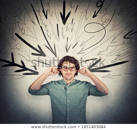 irritated businessman covering his ears stock photo © wavebreak_media