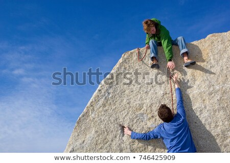 Climber helping fellow climber Stock photo © IS2