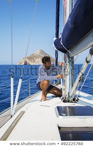 Sailor on sailboat at sea Stock photo © bluering