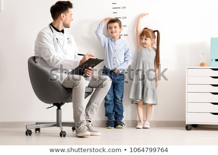 Doctor measuring height of young girl Stock photo © IS2