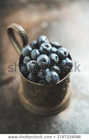 freshly picked blueberries in metallic cup stock photo © melnyk