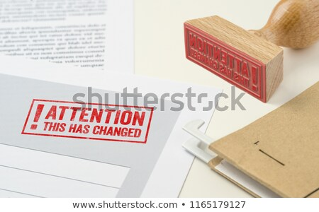 A red stamp on a document - This has changed Stock photo © Zerbor