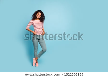 Full length photo of trendy attractive woman with curly hair in  Stock photo © deandrobot