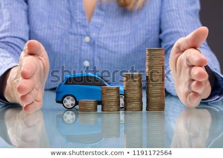 üzletasszony egymásra pakolva érmék kék autó kéz Stock fotó © AndreyPopov