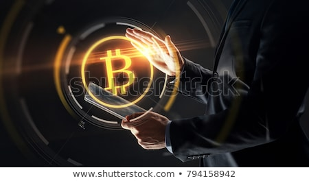 üzletember táblagép bitcoin hologram üzlet jövő Stock fotó © dolgachov
