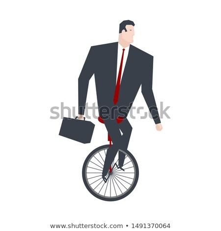 Businessman on Monocycle. Boss is balancing mono-bike. Office li Stock photo © MaryValery