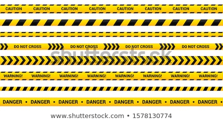 barricade tape for traffic and caution warning tape for warn or catch the attention tape containi stock photo © aisberg