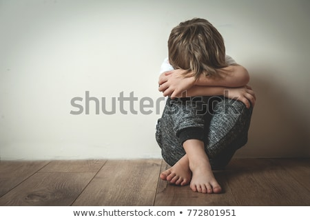hand on face upset problem child concept for bullying depression stress stock photo © lopolo