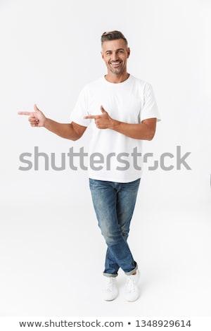 Stockfoto: Glimlachend · jonge · zakenman · permanente · geïsoleerd