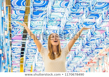 A young European woman in the background of Asian lanterns is celebrating the Chinese New Year Stock photo © galitskaya