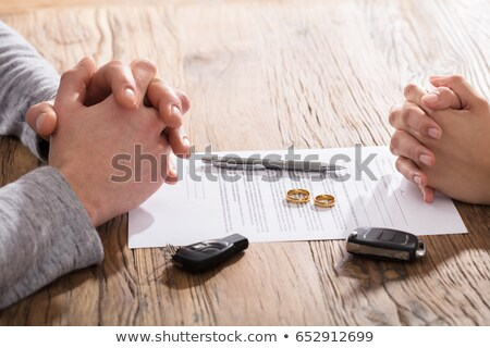 Hands On Divorce Document With Wedding Rings And Car Keys Stock photo © AndreyPopov