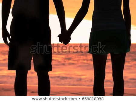 young couple watching an asian sunset stock photo © majdansky