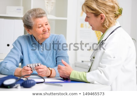 Doctor or Nurse Explaining Prescription Medicine to Senior Adult Stock photo © feverpitch