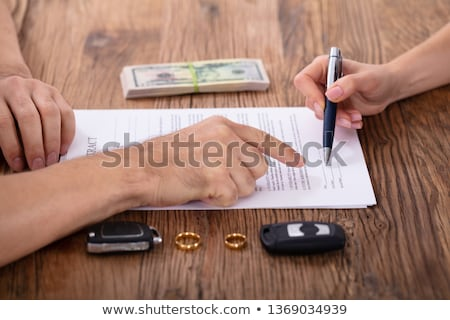 judge assisting client in filling contract form stock photo © andreypopov