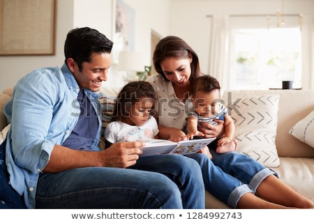 Stockfoto: Close Up Of Baby Boy And Father With Book At Home