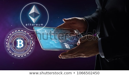 Stock photo: close up of businessman with bitcoin hologram