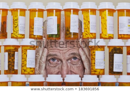 Man looks depressed with bottle in his hand. Stock photo © Lopolo