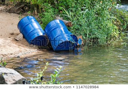 Blue toxic drums in river Stock photo © ldambies