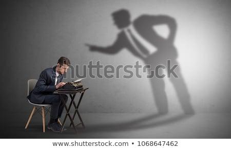 Férfi dolgozik árnyék veszekedik kicsi nagy Stock fotó © ra2studio