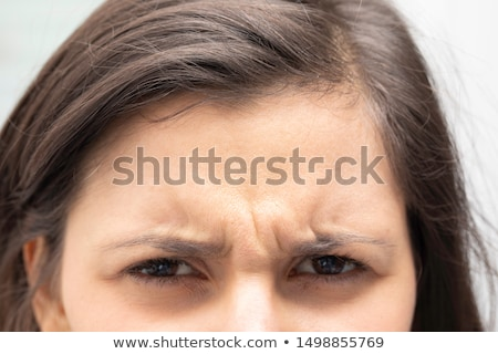 Woman wrinkles brow Stock photo © jsnover