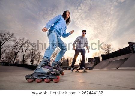 Férfiak város park korcsolya gördeszka emberek Stock fotó © robuart