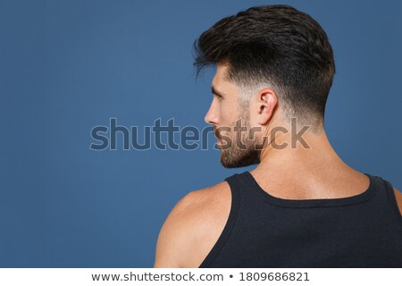 Attractive sportsman rear view, masculine strong back, athlete posing from behind, showing perfect b Stock photo © benzoix