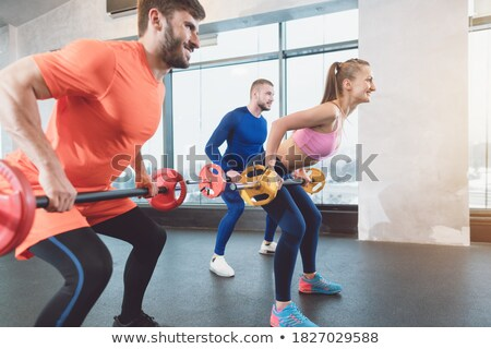 Personnes gymnase formation biceps muscle Photo stock © Kzenon