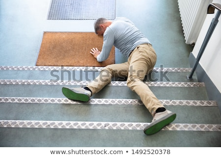 Slip And Fall Accident On Stairs Stock photo © AndreyPopov