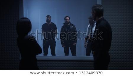 Group of policemen detain criminal Stock photo © jossdiim