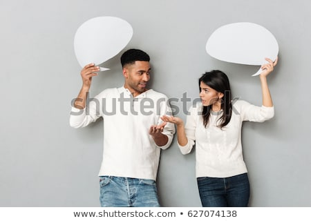 Woman and man holding paper thought bubbles Stock photo © GVS