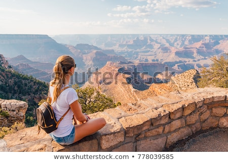 Girl hiker hiking on landscape trail in Grand Canyon National Park, USA. Adventure backpacker with b Stock photo © Maridav