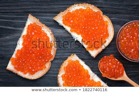 caviar red in wooden spoon Stock photo © konturvid