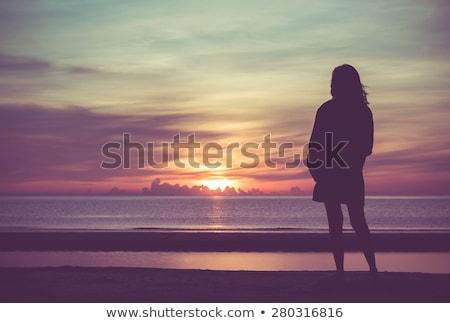 Lány néz óceán hajnal nyitva felhők Stock fotó © silent47