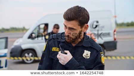 Traffic guard speaking into his walkie talkie Stock photo © photography33