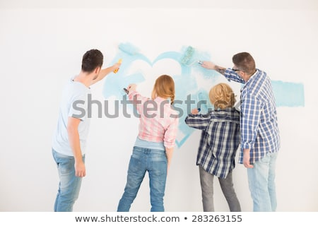 three female friends painting wall stock photo © photography33