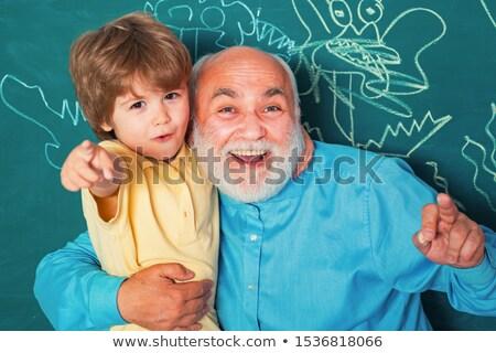 öğretmen · öğrenci · geri · poz · kamera - stok fotoğraf © stockyimages