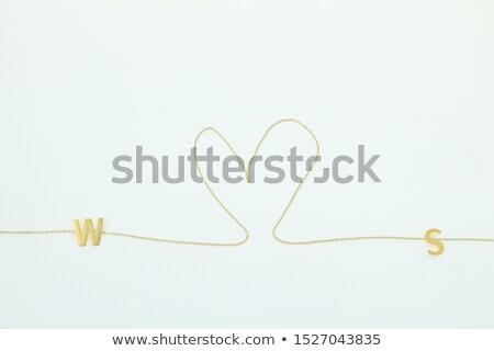 Lady jeweller making pendant Stock photo © backyardproductions