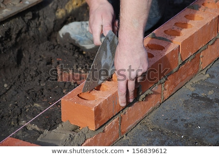 A tradesman laying a brick Stock photo © photography33
