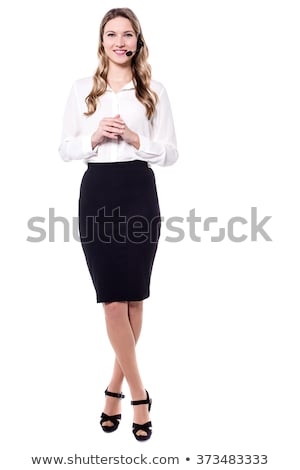call centre executive posing with headset stock photo © stockyimages