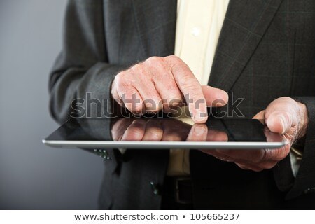 Finger of a man on tablet pc screen, closeup shot Stock photo © stockyimages
